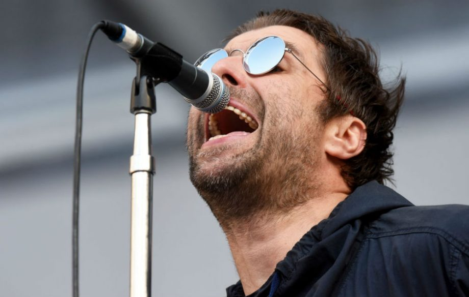 Liam Gallagher joined by Bonehead during Rolling Stones
